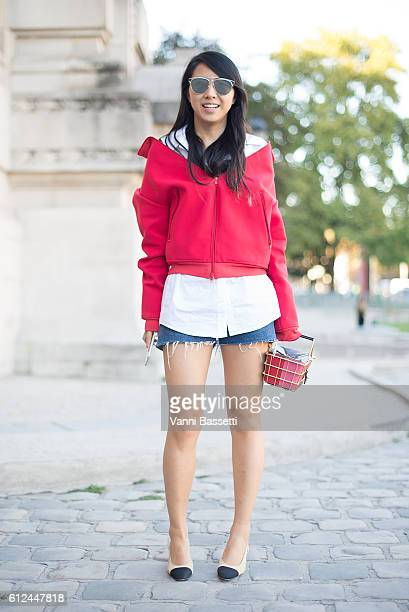 Yuwei Zhangzou poses wearing a Balenciaga jacket and Chanel shoes before the Shiatzy Chen show at the Grand Palais during Paris Fashion Week SS17 on...