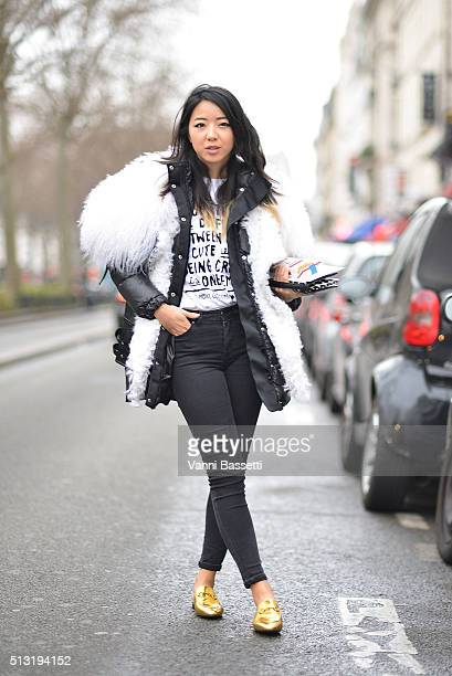 Yuwei Zhangzou poses wearing a Sacai jacket before the Each X Other show at the Petit Trianon during Paris Fashion Week Fall/Winter 16/17 on March 1...