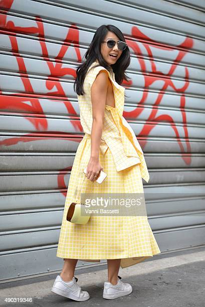 Yuwei Zhangzou poses wearing a Steven Tai dress after the Marni show during the Milan Fashion Week Spring/Summer 2016 on September 27 2015 in Milan...