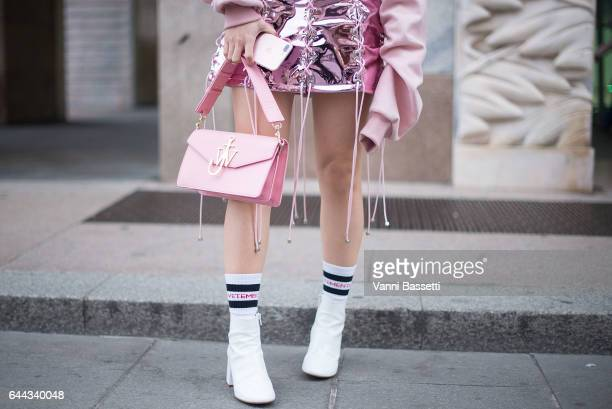 Yuwei Zhangzou poses wearing an Angel Chen skirt and a JW Anderson bag after the Angel Chen show during Milan Fashion Week Fall/Winter 2017/18 on...