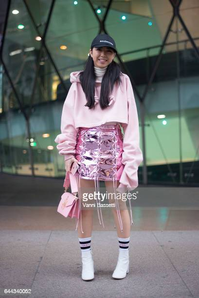 Yuwei Zhangzou poses wearing an Angel Chen skirt Balenciaga cap and a JW Anderson bag after the Angel Chen show during Milan Fashion Week Fall/Winter...