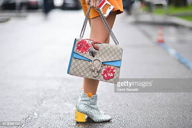 Yuwei Zhangzou poses wearing Chiara Ferragni shoes and Gucci bag after the Giorgio Armani show during the Milan Fashion Week Fall/Winter 2016/17 on...
