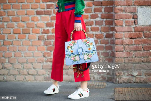 Yuwei Zhangzou poses wearing Gucci before the Gucci show during Milan Fashion Week Fall/Winter 2017/18 on February 22 2017 in Milan Italy