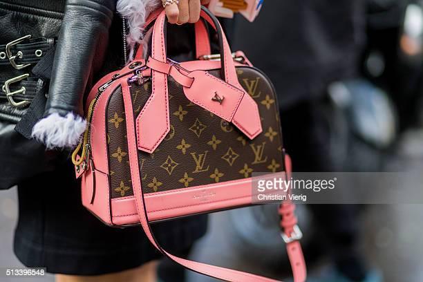 Yuwei Zhangzou wearing a pink Louis Vuitton bag outside Rochas during the Paris Fashion Week Womenswear Fall/Winter 2016/2017 on March 2 2016 in...