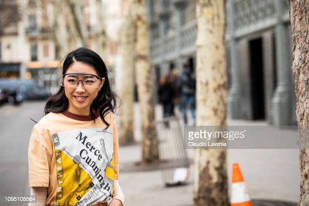 Yuwei Zhangzou wearing a printed tshirt and transparent sunglasses is seen in the streets of Paris before the Acne Studio show on January 16 2019 in...