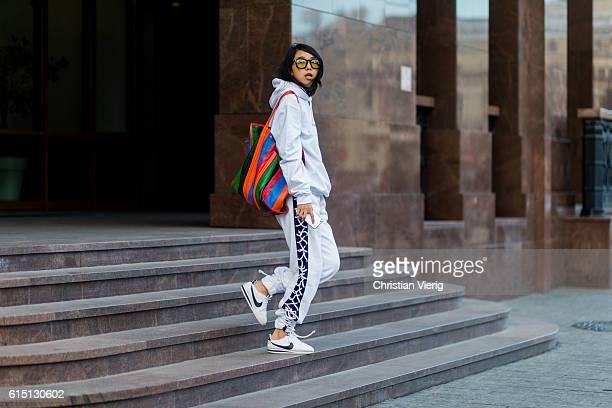 Yuwei Zhangzou wearing a white hoody from famt fenty sweat pants puma x rihanna Balenciaga bag on October 16 2016 in Moscow Russia