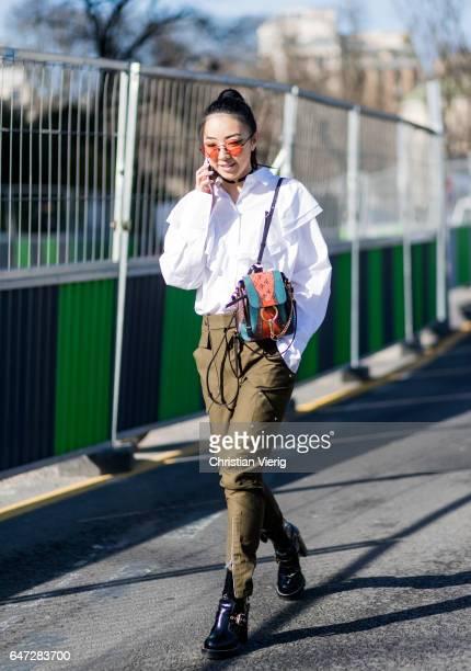 Yuwei Zhangzou wearing a white shirt olive military pants Chloe mini backpack outside Chloe on March 2 2017 in Paris France