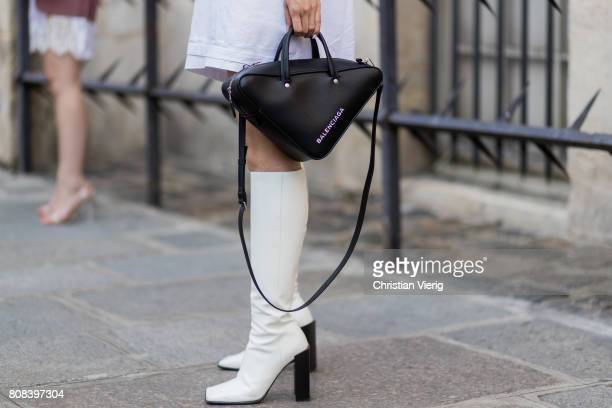 Yuwei Zhangzou wearing Balenciaga bag white boots outside Ulyana Sergeenko during Paris Fashion Week Haute Couture Fall/Winter 20172018 Day Three on...
