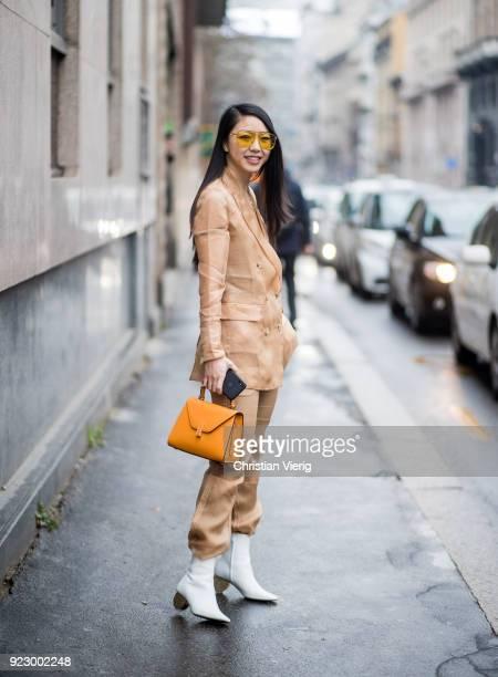 Yuwei Zhangzou wearing beige suit seen outside Max Mara during Milan Fashion Week Fall/Winter 2018/19 on February 22 2018 in Milan Italy