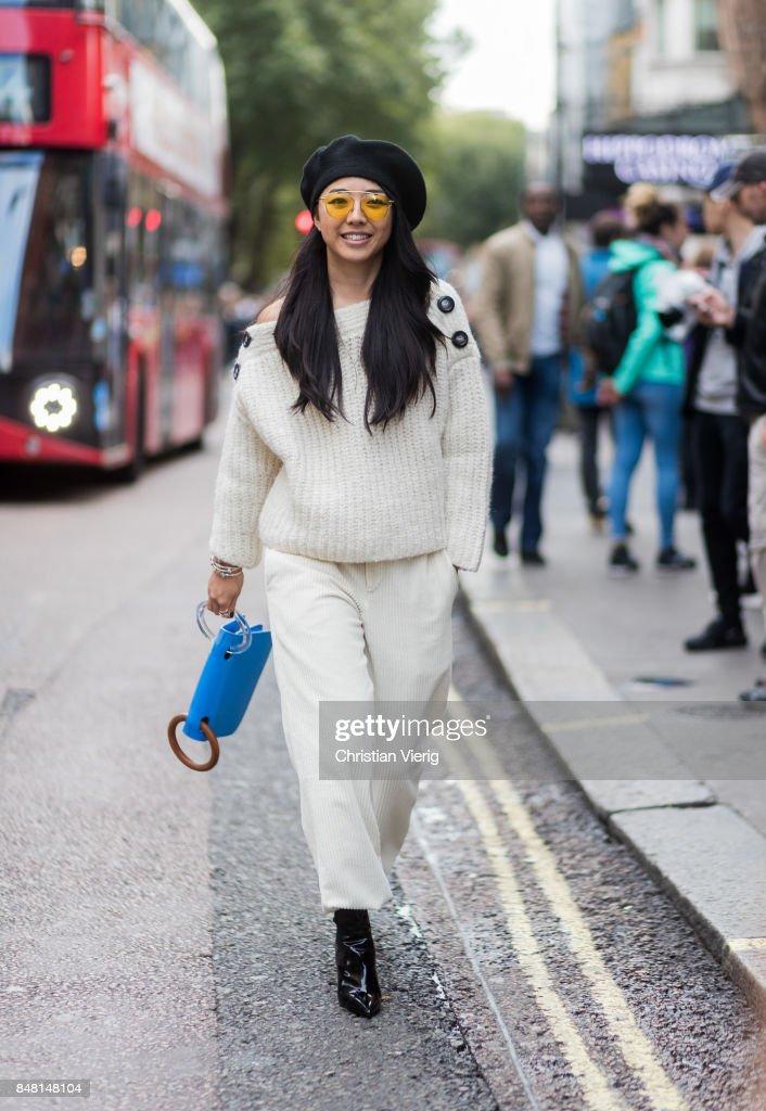 Yuwei Zhangzou wearing beret outside House of Holland during London Fashion Week September 2017 on September 16, 2017 in London, England.