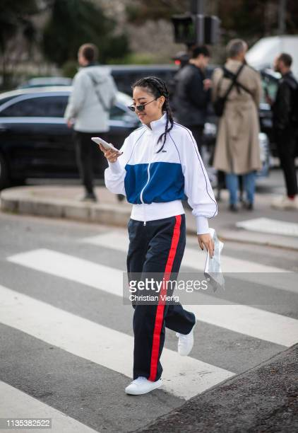 Yuwei Zhangzou wearing jogger and track suit jacket is seen outside Lacoste during Paris Fashion Week Womenswear Fall/Winter 2019/2020 on March 05...
