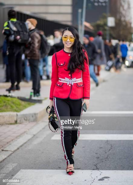 Yuwei Zhangzou wearing red jacket black pants bag seen outside Gucci during Milan Fashion Week Fall/Winter 2018/19 on February 21 2018 in Milan Italy