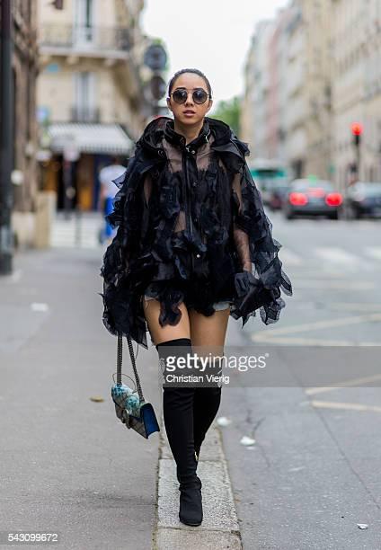 Yuwei Zhangzou wearing Sacai and a Gucci bag outside Etudes during the Paris Fashion Week Menswear Spring/Summer 2017 on June 25 2016 in Paris France