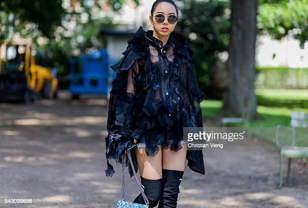 Yuwei Zhangzou wearing Sacai and a Gucci bag outside Sacai during the Paris Fashion Week Menswear Spring/Summer 2017 on June 25 2016 in Paris France