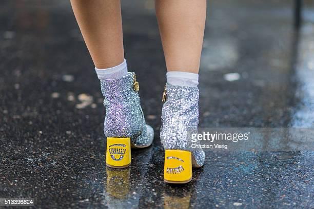 Yuwei Zhangzou wearing silver Chiara Ferragni Collection boots outside Rochas during the Paris Fashion Week Womenswear Fall/Winter 2016/2017 on March...
