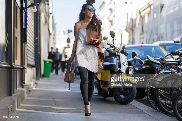Yuwei Zhangzou wearing Spektre Sunglasses Keepsake dress Acne denim during Paris Fashion Week Womenswear Spring/Summer 2016 on September 30 2015 in...