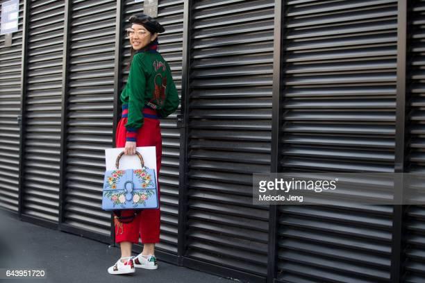 Yuwei Zhangzou wears Gucci outside the Gucci show during Milan Fashion Week Fall/Winter 2017/18 on February 22 2017 in Milan Italy