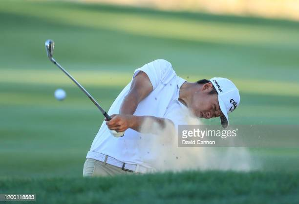 Yuxin Lin of China plays his second shot on the fifth hole during the second round of the Abu Dhabi HSBC Championship at Abu Dhabi Golf Club on...