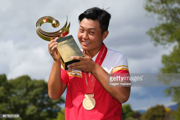 Yuxin Lin of China poses with the AsiaPacific Amateur Championship trophy during the AsiaPacific Amateur Championship at Royal Wellington Golf Club...