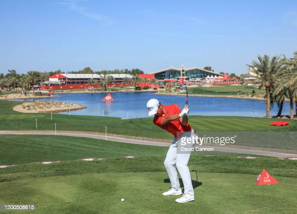Yuxin Lin of China the only amateur to make the cut plays his tee shot on the 18th hole during the final round of the Abu Dhabi HSBC Championship at...