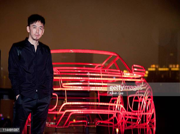 Yuxing Huang of China for a picture with Range Rover Evoque wireframe at outside the Waterhouse on May 21 2011 in Shanghai China