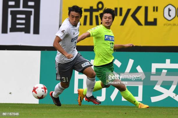 Yuya Hashiuchi of Matsumoto Yamaga and Hirotaka Tameda of JEF United Chiba compete for the ball during the JLeague J2 match between JEF United Chiba...