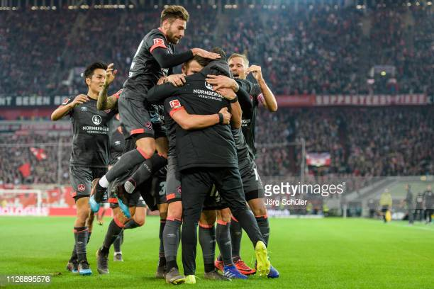 Yuya Kubo, Enrico Valentini, Eduard Loewen and Hanno Behrens of Nuernberg celebrating their 0-1 lead during the Bundesliga match between Fortuna...