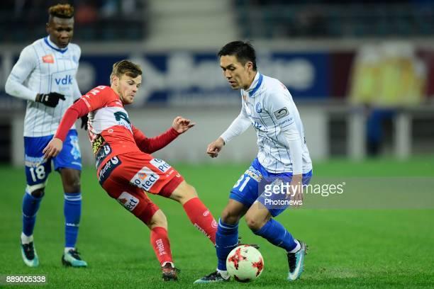Yuya Kubo forward of KAA Gent is challenged by Kristof D'Haene midfielder of KV Kortrijk during the Jupiler Pro League match between KAA Gent and KV...