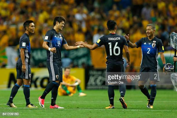 Yuya Kubo Hiroki Sakai Hotaru Yamaguchi and Yosuke Ideguchi of Japan celebrate their 20 victory and qualified for the FIFA World Cup Russia after the...