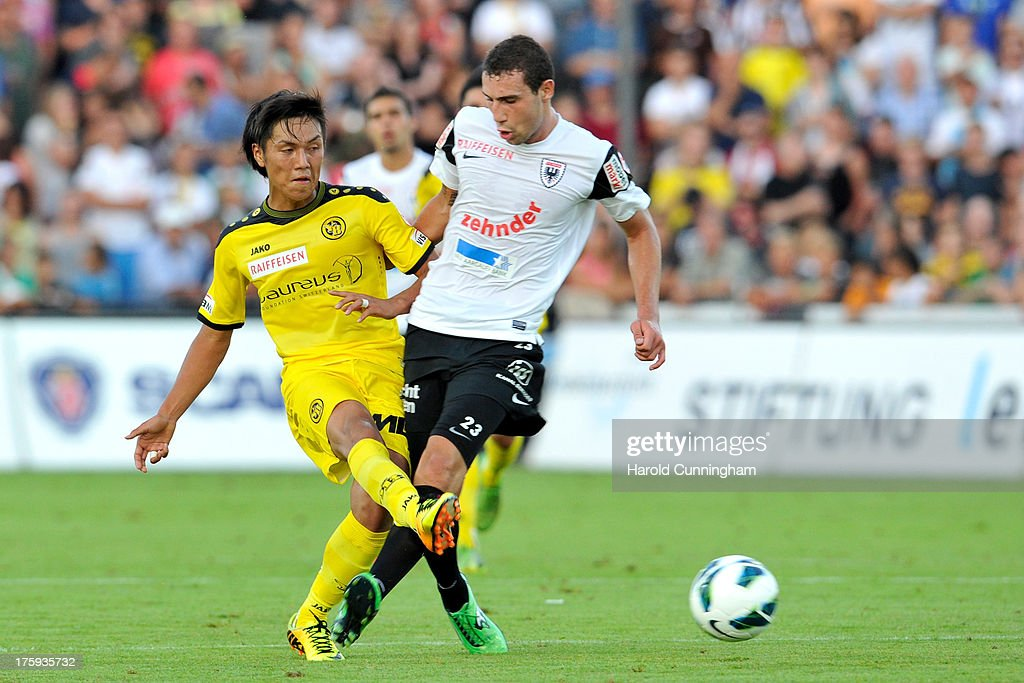 Yuya Kubo of BSC Young Boys fights for the ball with Artur Ionita of FC Aarau during the Swiss Super League match between FC Aarau v BSC Young Boys at Brugglifeld on August 10, 2013 in Aarau, Switzerland.