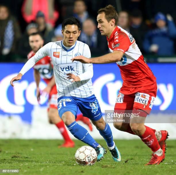 Yuya Kubo of Gent and Yevhen Makarenko of Kortrijk vie for the ball in the second half of a Belgian Cup quarterfinal match against in Kortrijk...
