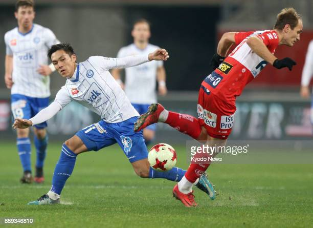 Yuya Kubo of Gent challenges for the ball against Yevhen Makarenko of Kortrijk in the second half of a Belgian first division soccer match at...