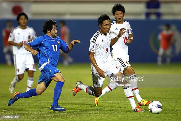 Yuya Kubo of Japan and M Alqabandi of Kuwait compete for the ball during the AFC U19 Championship Group A match between Kuwait and Japan at Emirates...