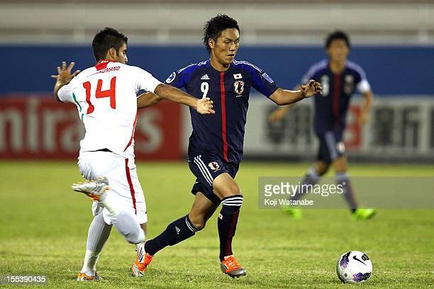 Yuya Kubo of Japan and M Moradmand of Iran compete for the ball during the AFC U19 Championship Group A match between Japan and Iran at Emirates...