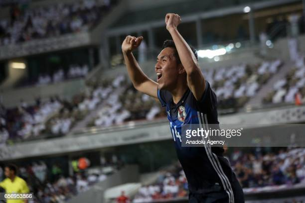 Yuya Kubo of Japan celebrates after scoring a goal during the 2018 FIFA World Cup Asian Qualifying group B football match between United Arab...
