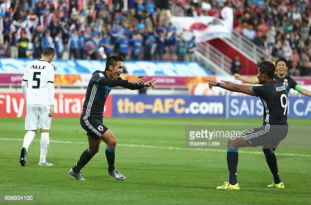 Yuya Kubo of Japan celebrates scoring the opening goal during the AFC U23 Championship semi final match between Japan and Iraq at the Abdullah Bin...