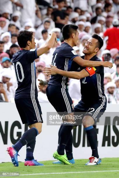 Yuya Kubo of Japan celebrates scoring the opening goal with his team mates Shinji Kagawa and Maya Yoshida during the FIFA 2018 World Cup qualifying...