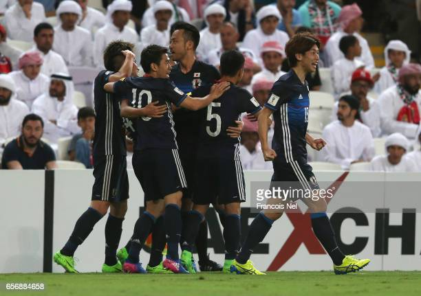 Yuya Kubo of Japan celebrates with team mates as he scores their first goal during the FIFA 2018 World Cup qualifying match between United Arab...