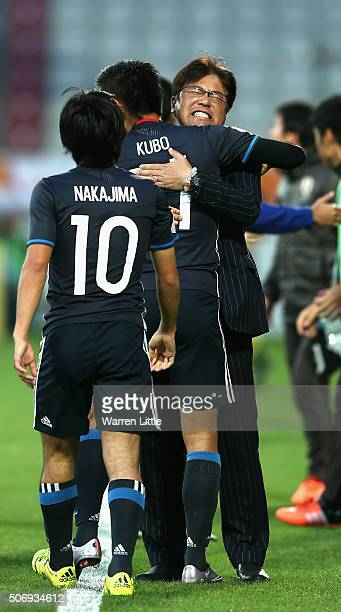 Yuya Kubo of Japan congratulated by Makoto Teguramori Head Coach of Japan after scoring the opening goal during the AFC U23 Championship semi final...