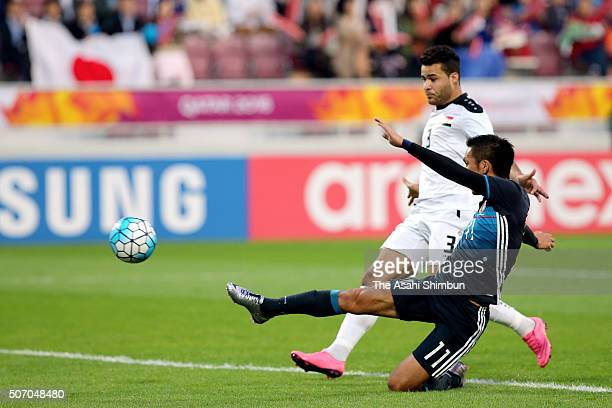 Yuya Kubo of Japan scores his team's first goal during the AFC U23 Championship semi final match between Japan and Iraq at the Abdullah Bin Khalifa...