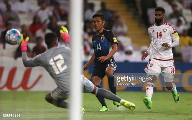 Yuya Kubo of Japan shoots past goalkeeper Khalid Eisa of United Arab Emirates to score their first goal during the FIFA 2018 World Cup qualifying...