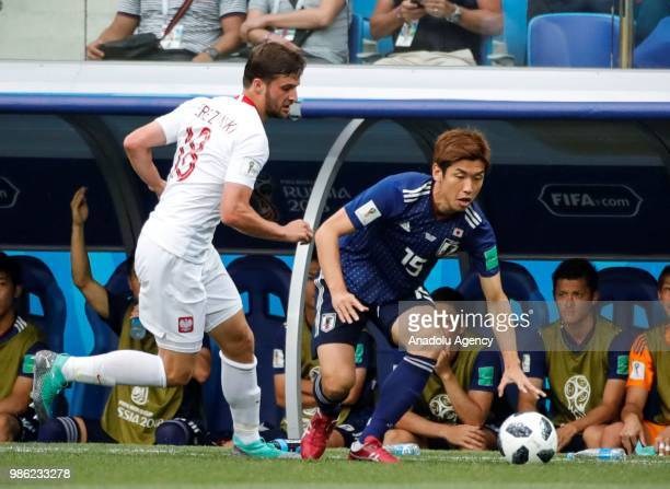 Yuya Osaka of Japan in action against Bartosz Bereszynski of Poland during the 2018 FIFA World Cup Russia Group H match between Japan and Poland at...