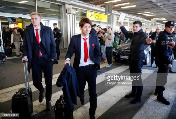 Yuya Osako and Frederik of FC Koeln arrives at Nikola Tesla Airport ahead of the UEFA Europa League group H match between Crvena Zvezda and FC Koeln...
