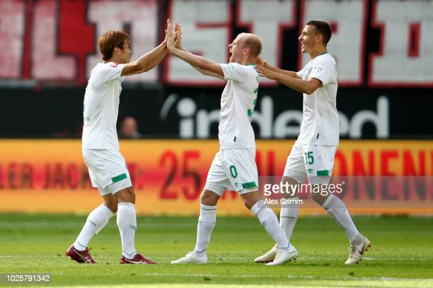 Yuya Osako, Davy Klaassen and Maximilian Eggestein of Werder Bremen celebrates after Yuya Osako of Werder Bremen scored their team's first goal...