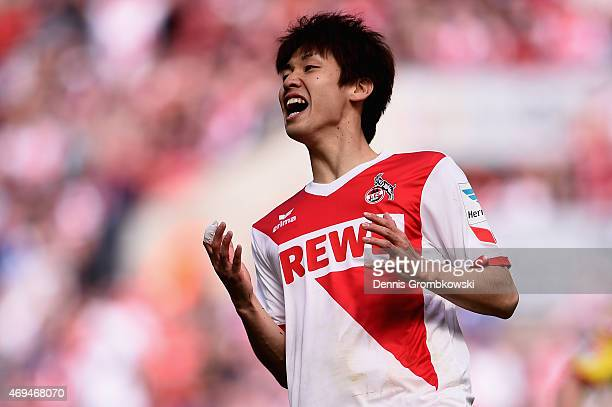 Yuya Osako of 1 FC Koeln despairs after missing a chance at goal during the Bundesliga match between 1 FC Koeln and 1899 Hoffenheim at...
