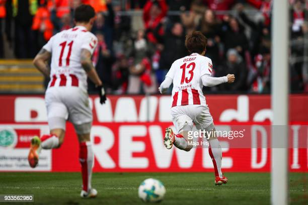 Yuya Osako of 1FC Koeln celebrates with his teammates after scoring his teams first goal during the Bundesliga match between 1 FC Koeln and Bayer 04...