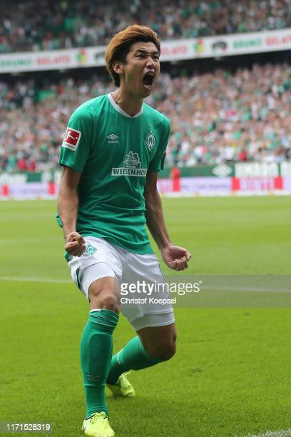Yuya Osako of Bremen celebrates the third goal during the Bundesliga match between SV Werder Bremen and FC Augsburg at Wohninvest Weserstadion on...