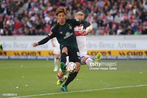 Yuya Osako of Bremen challenges Timo Baumgartl of Stuttgartduring the Bundesliga match between VfB Stuttgart and SV Werder Bremen at MercedesBenz...