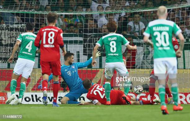 Yuya Osako of Bremen scores his team's first goal during the DFB Cup semi final match between Werder Bremen and FC Bayern Muenchen at Weserstadion on...