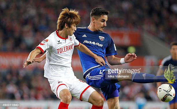 Yuya Osako of Cologne challenges Alfredo Morales of Ingolstadt during the Bundesliga match between 1 FC Koeln and FC Ingolstadt at...
